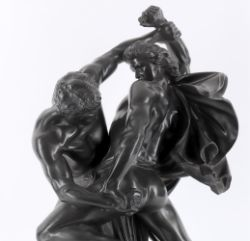 An early 20th century Danish black glazed basalt figural group of two warriors in combat