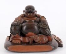 A Chinese carved wood figure of Budai