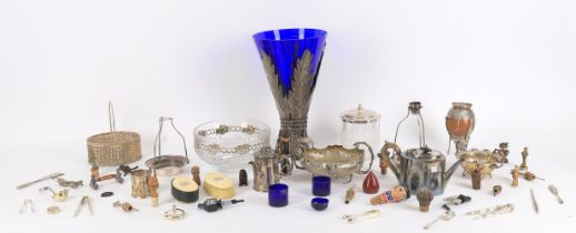 A collection of silver plated items including a large leaf mounted blue glass vase