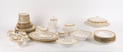A Spode porcelain dinner service in the 'Fleur de lys gold' pattern