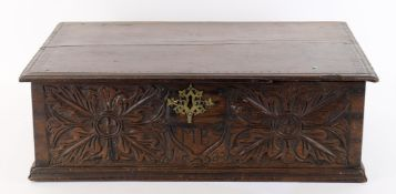 A 17th century and later oak box with carved decoration