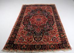 Three rugs including a Tabriz pattern North West Persian rug