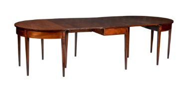 A mahogany and crossbanded D-end dining table