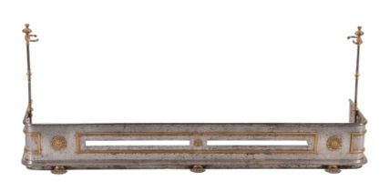 An early 19th century polished steel and gilt brass fire fender