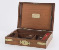 Lund - An early 19th century mahogany and brass bound dressing case