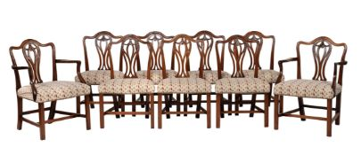 A set of nine George III mahogany and upholstered dining chairs