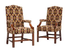 A pair of mahogany and tapestry upholstered open armchairs in George III style