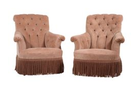A pair of pink upholstered armchairs in late 19th century style