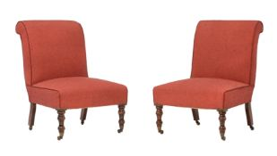 A pair of stained beech and upholstered side chairs in Victorian taste