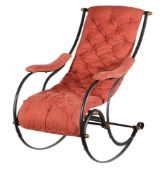 A cast iron and upholstered rocking armchair in Victorian style