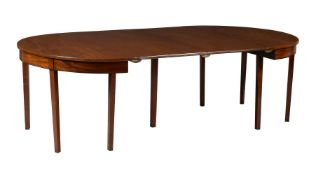 A mahogany dining table in George III style