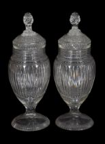 A pair of Continental cut-glass pedestal urns and covers with facetted ball stoppers