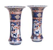 A pair of Imari pierced beaker vases
