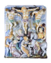 An Italian maiolica wall tile moulded in relief with The Crucifixion