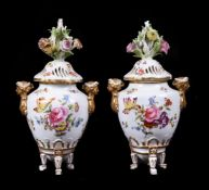 A pair of Meissen pot pourri urns and pierced covers