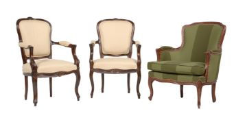 A pair of stained beech armchairs