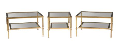 A suite of four gilt brass and glass topped tables
