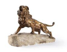 A bronze model of a lion on a stone base