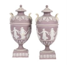 A pair of Wedgwood lilac-dip Jasper two handled urns and covers