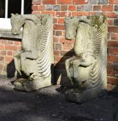 A pair of carved stone table ends