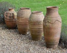 A pair of terracotta baluster garden vases