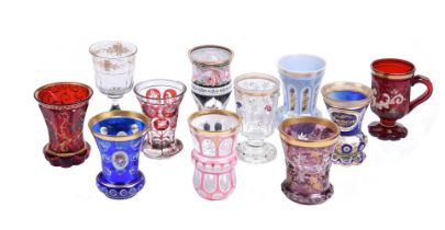 A group of nine Bohemian coloured glass beakers
