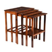 A set of Art Nouveau mahogany and inlaid quartetto tables