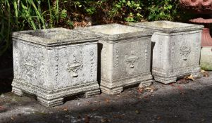 A set of three composition stone planters