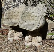 A pair of stone composite cast garden tub chairs