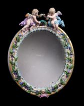 A Meissen flower encrusted and gilt metal mounted oval strut looking glass