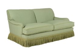 A green upholstered sofa in late 19th century taste by Kingcome sofas