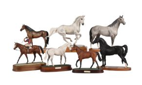 A collection of seven various ceramic equestrian models