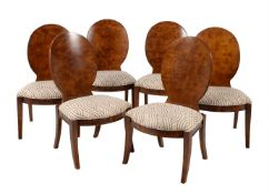 A set of twelve burr walnut and upholstered dining chairs in Art Deco style