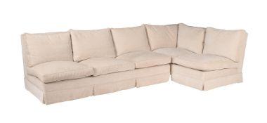 A white upholstered corner sofa