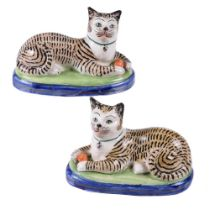 A pair of Staffordshire pottery models of cats of William Kent Ltd.