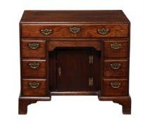 A George II 'red walnut' kneehole desk