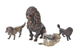 A group of bronze figures of dogs