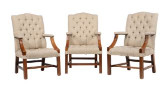 A set of three mahogany and upholstered armchairs in George III style
