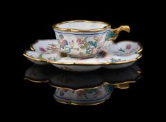 An unusual Chinese enamel cup and saucer