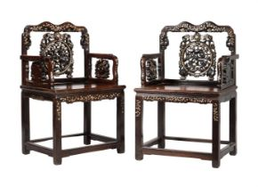 A pair of Chinese carved hardwood and mother of pearl armchairs