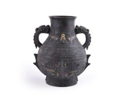 A large Chinese inlaid bronze vase