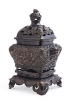 A Chinese bronze rectangular shaped two-handled censer and cover and openwork stand