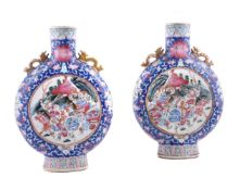 A pair of Chinese famille rose moon flasks