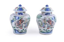 A pair of Wucai vases and covers