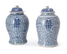 A pair of Chinese blue and white 'marriage' vases and covers