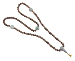 A Chinese jadeite and possibly aloeswood necklace