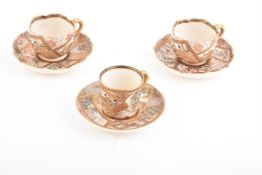 A Pair of Satsuma Pottery Cups and Saucers