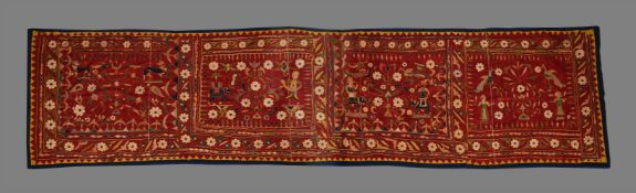 An Indian long embroidered hanging