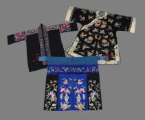 A Chinese women's embroidered side fastening robe