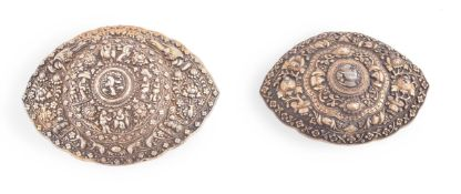 Two Chinese Straits silver-gilt repoussé buckles